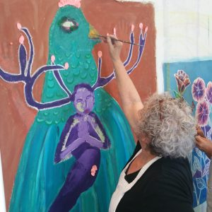 woman painting spiritual art